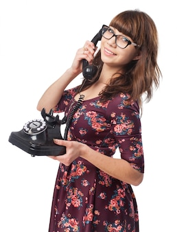 Pretty girl posing while talking on phone