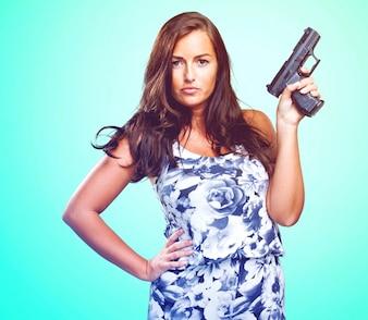 Pretty mafia woman holding a gun