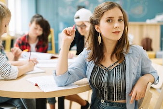 Pretty student posing in class