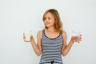 Pretty Woman Choosing Between Water and Milk