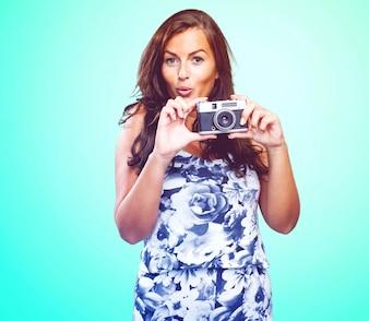 Pretty woman holding a camera