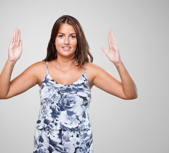 Pretty woman holding something gesture