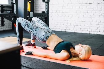 Pretty woman lifting hips