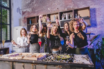 Pretty women celebrating and having party