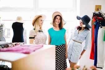 Pretty women fitting hats