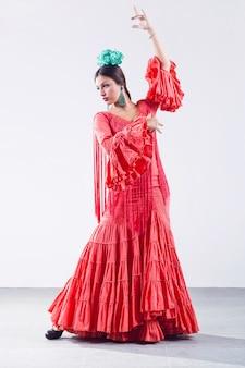 Pretty young flamenco dancer in beautiful dress.