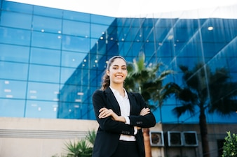 Professional businesswoman in front of modern building