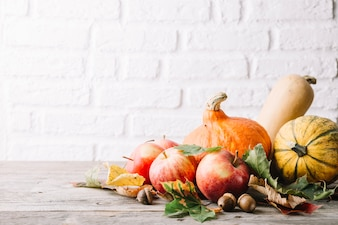 Pumpkins and apples composed with foliage