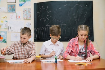 Pupils in classroom painting