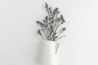 Purple flowers on white vase