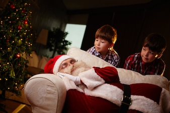 Quiet brothers with santa claus