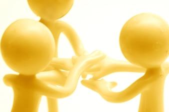 Rag dolls with hands together