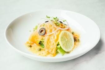 Raw and fresh carpaccio salmon meat