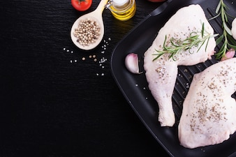 Raw chicken legs with herbs