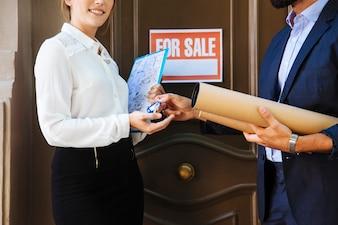 Real estate agent handing over key