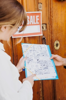Real estate agent with plan