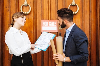 Real estate agents in front of a door