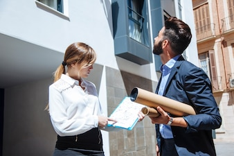 Real estate agents in front of building