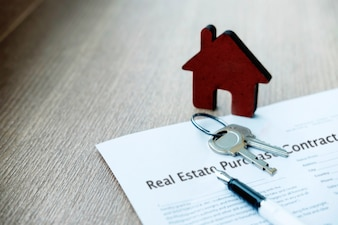 Real estate purchase and insureance concept idea. Sale and buy land and house.