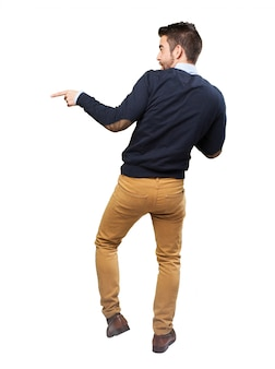 Rear view of young man dancing