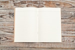 Recycled paper book on wood background