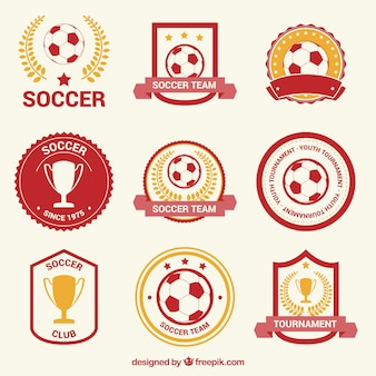 Red and gold football badges