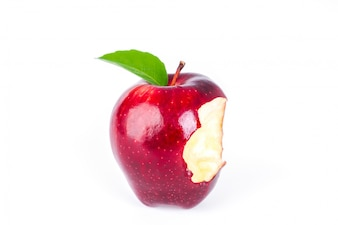 Red apple with green leaf and missing a bite .
