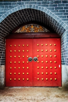 Red door with gold button decoration