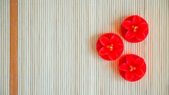 Red flower-shaped candles