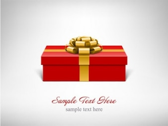 Red gift box with glossy gold bow