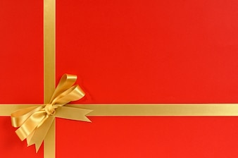 Red gift with golden ribbon