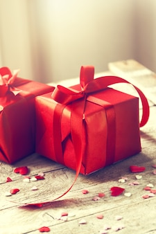 Red gifts with red bow on a table