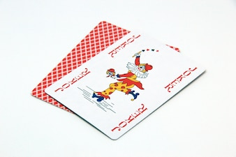 Red joker card on white background