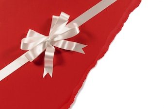 Red paper gift with decorative bow