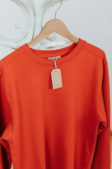 Red pullover with tag