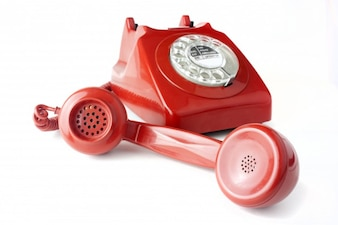 Red telephone on white background