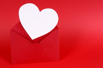 Red valentine envelope with a white heart