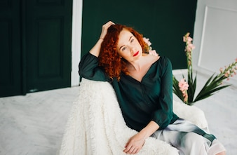Redhead woman sitting in chair