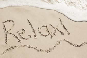 Relax written on sand