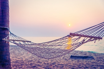 Relaxation evening sun swing ocean