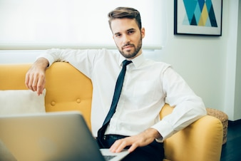 Relaxed businessman sitting on the couch