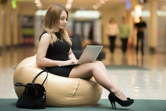 Relaxed executive with her laptop