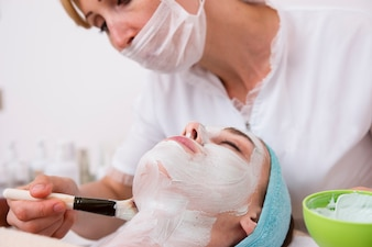 Relaxed woman taking care of her skin