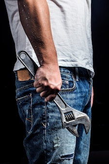 Repairman holding a wrench