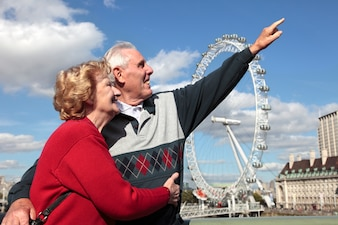 Retired couple in london with millenium wheel