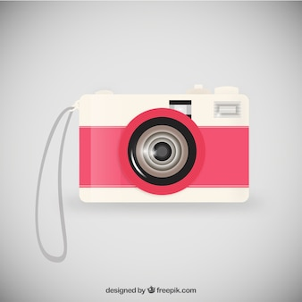 Retro camera in pink and white color