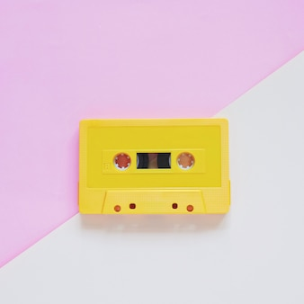Retro cassette tape on pastel color background, minimal style