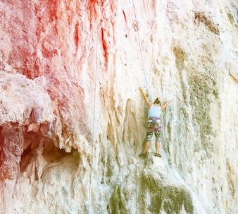 Retro Color of Rock climbers climbing the wall on Railay beach,