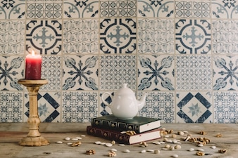 Retro decoration with tea pot and nuts