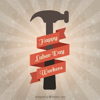 Retro labor day background with a hammer